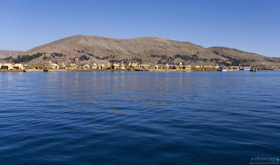 Озеро Титикака расположено на границе Перу и Боливии, на ...