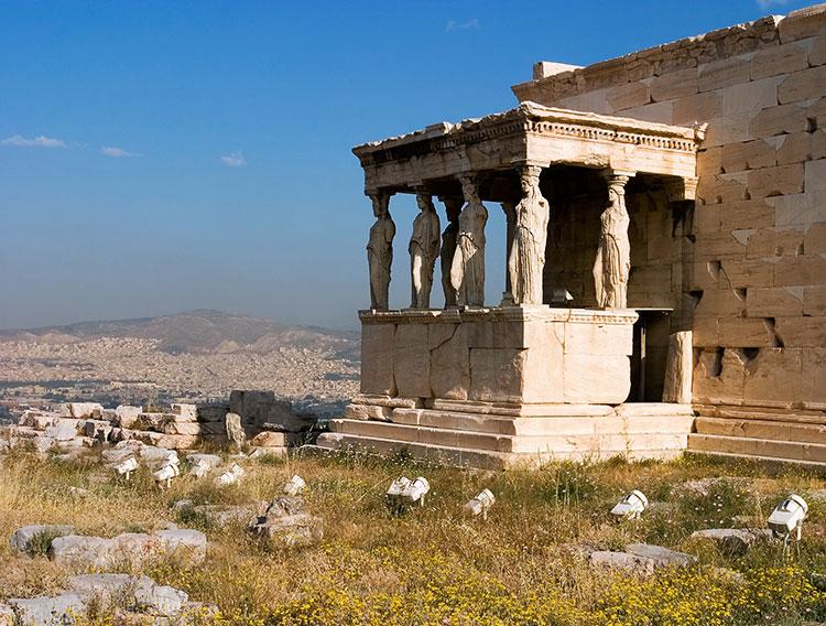 Весенние цветы и портик с кариатидами.  Акрополь Афины, Греция, Athens, Greece photo.